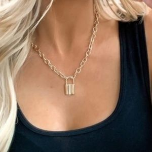 Gold lock pendant necklace